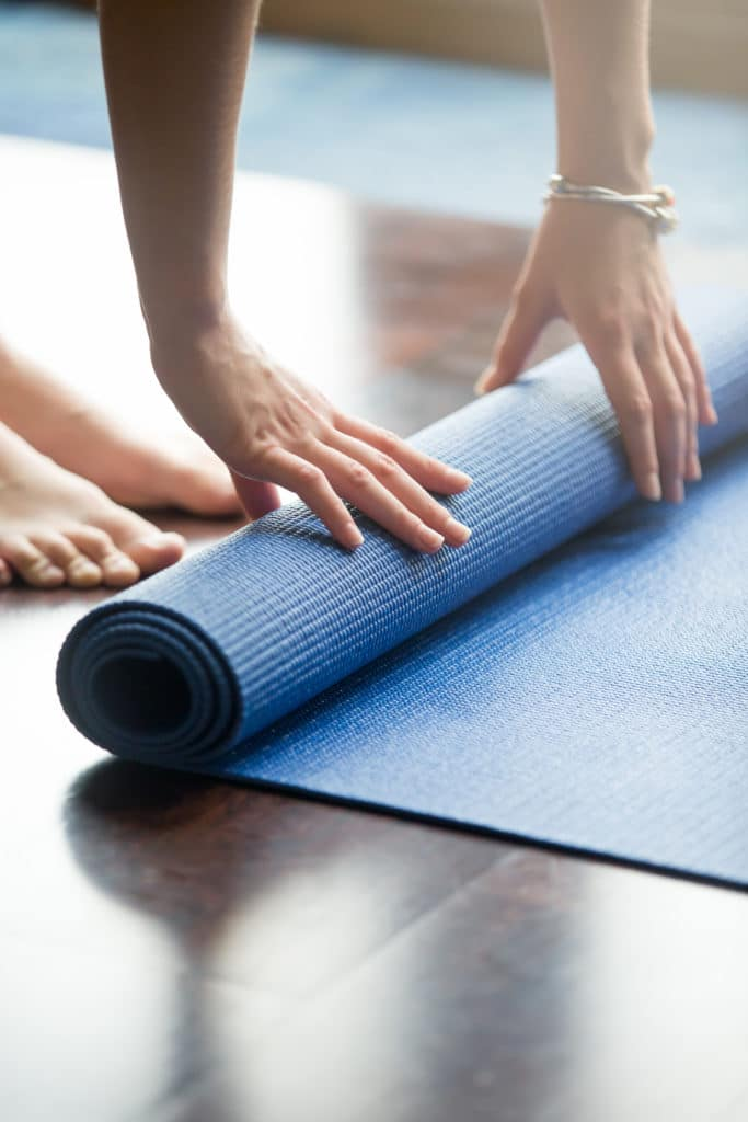 rolling out the yoga mat